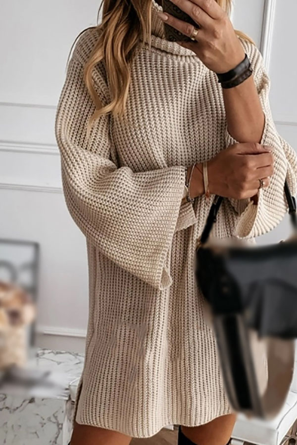 Loose knit dress with turtleneck and flared sleeves